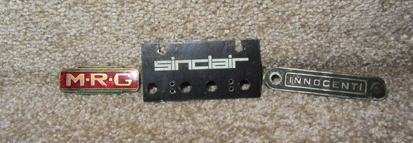 3X INSTRUMENT BADGES, INNOCENTI SEAT BADGE, SINCLAIR RADIONICS, M.R.G, MRG RADIO ENAMEL BADGE