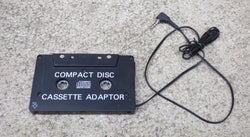 COMPACT DISC - CASSETTE ADAPTOR TO ALLOW CD PLAYER, iPOD, MP3 PLAYER TO BE USED IN CAR
