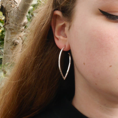 Large teardrop hammered hoop earring