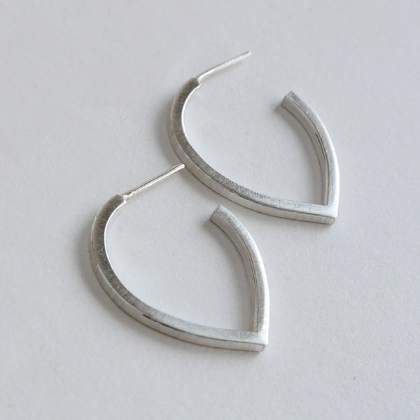 Teardrop hammered hoop earring