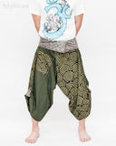 active cropped samurai pants wrap around waist brown tribal sayagata design flexible airy wide legs japanese spiral all green warrior trousers front