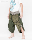 active cropped samurai pants wrap around waist brown tribal sayagata design flexible airy wide legs japanese spiral all green warrior trousers left