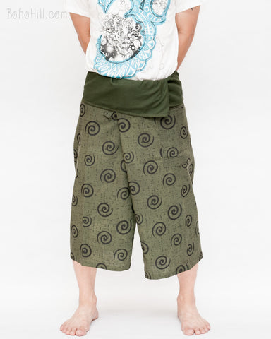 loose fit wrap around fold over waist cropped yoga pants flexible low crotch summer shin length capri fisherman pants primitive tribal spiral green front