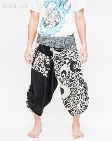 tribal samurai warrior active pants ninja cropped flexible pants indigo fold over waist loose yoga trousers japanese hakama abstract motif black and white front