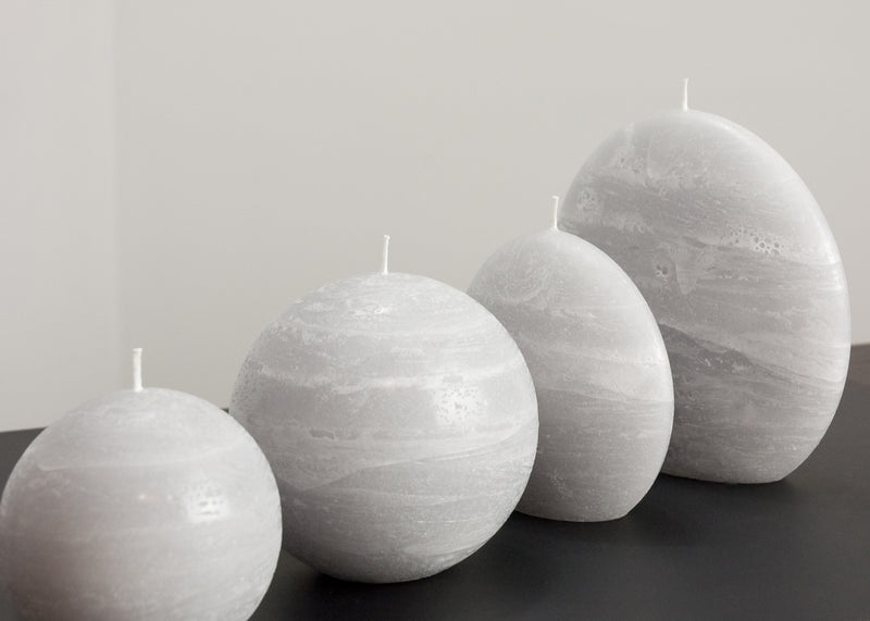 Collection of stone quarry candles in gray blue and black by Nordic Candle