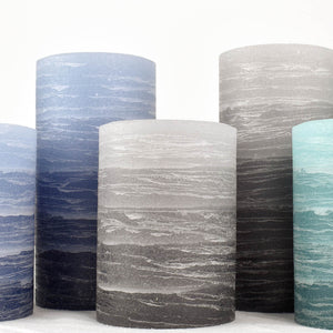 Collection of layered striped pillar candles by Nordic Candle