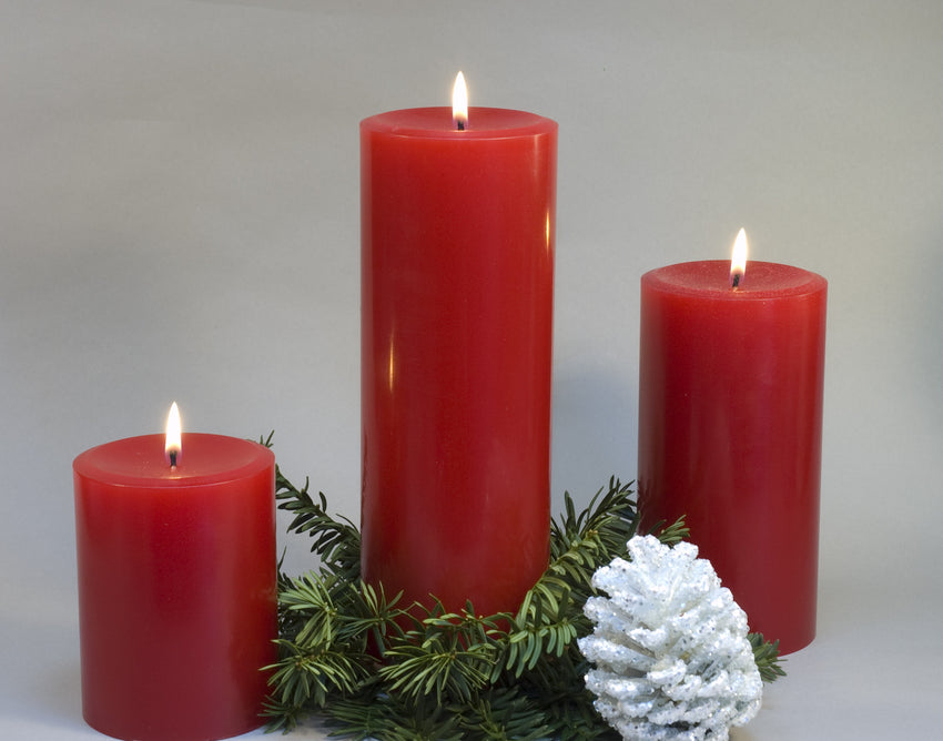 grouping of red short and tall pillar candles by Nordic Candle