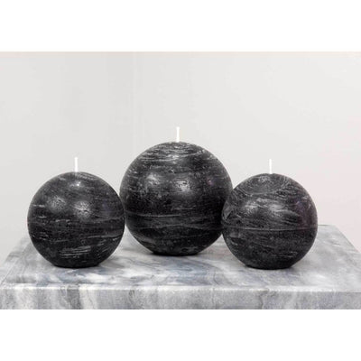 black ball candle with a rustic texture surface 3 and 4 inch diameter by Nordic Candle img2