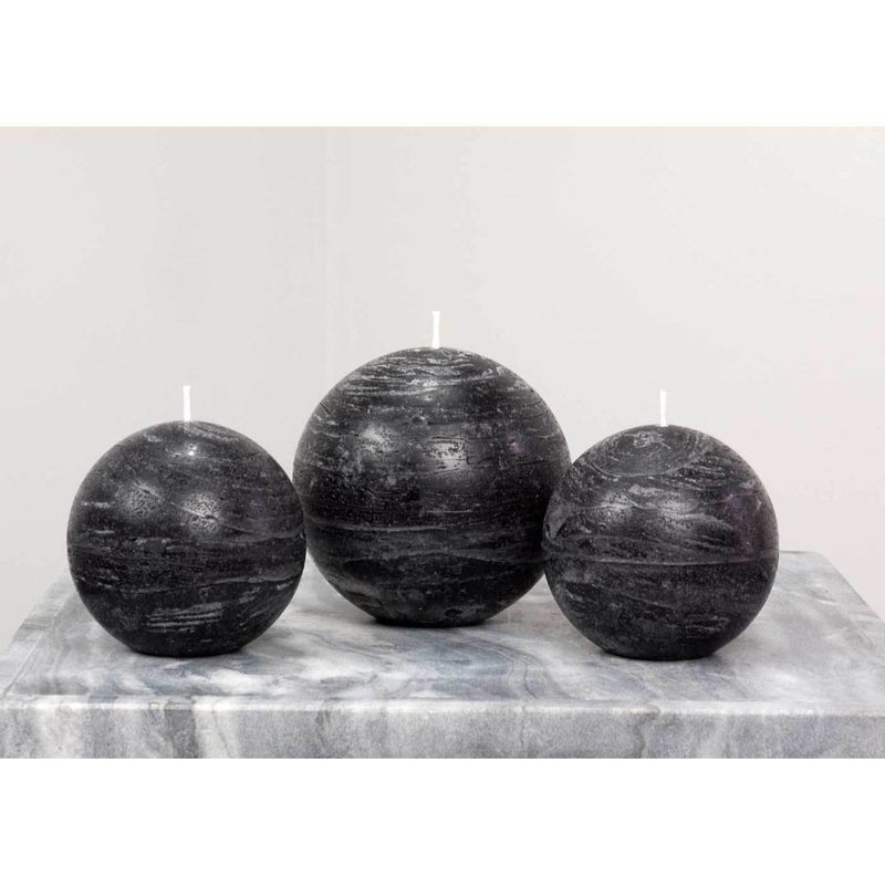 black ball candle with a rustic texture surface 4 inch diameter by Nordic Candle white background img1