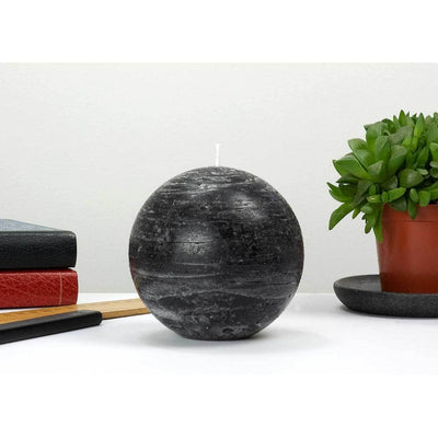 black ball candle with a rustic texture surface 4 inch diameter by Nordic Candle img3