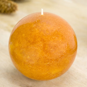 Burnt orange candle in a round ball 4