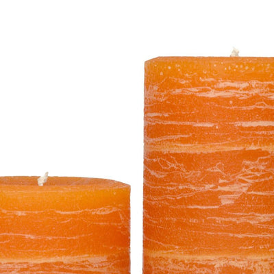orange pillar candle part of rustic candle collection available in sizes 3x4 3x6 3x9 4x6 4x9 hand poured artisan candles by Nordic Candle
