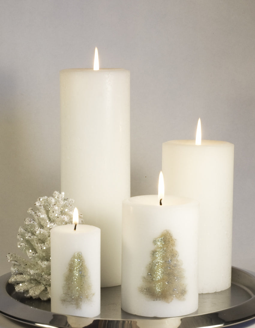 Christmas Candles grouped white pillar candles with a Christmas Tree by Nordic Candle