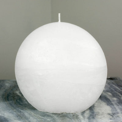 White Candle Rustic Disc 5.75 inches wide 2.35 deep and 5.5 inches tall artisan handmade by Nordic Candle