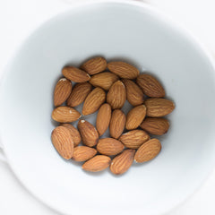 small bowl of almonds as a healthy night time snack for better sleep quality