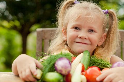 young girl with plate full of vegetables