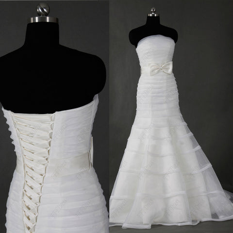 Mermaid wedding dress with trims