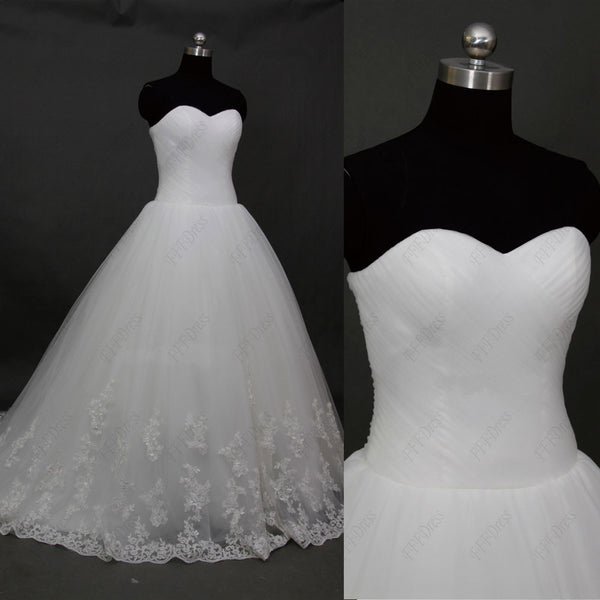 Sweetheart princess wedding dress with lace hem
