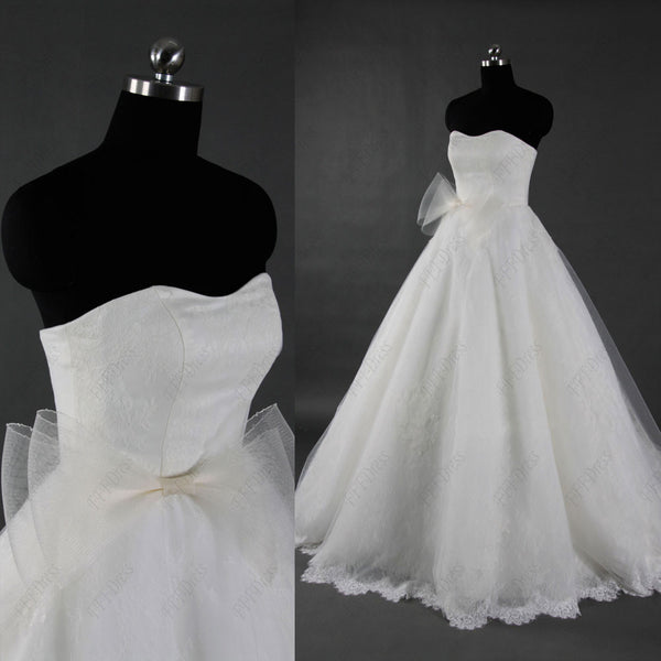 Lace sweetheart ball gown wedding dress with sash