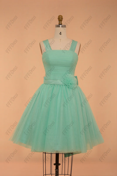 Mint green ball gown bridesmaid dress with bow