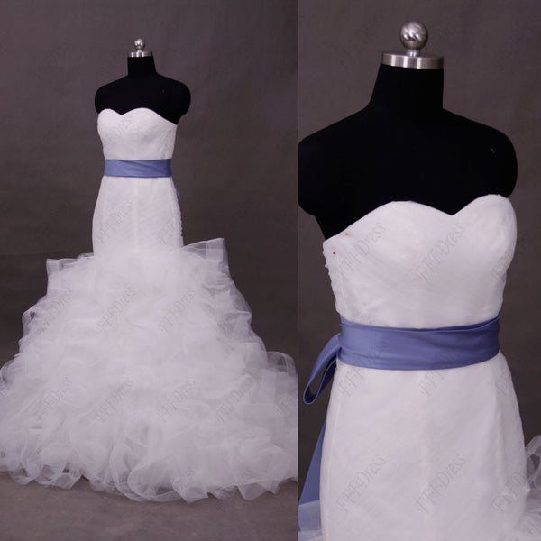 Mermaid sweetheart wedding dress with ruffled skirt and wide trim