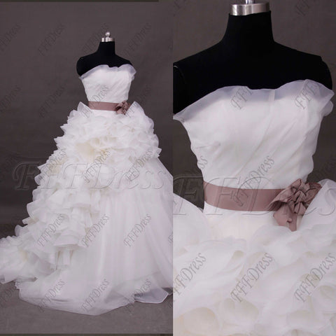 Ball gown wedding dress with dusty rose sash