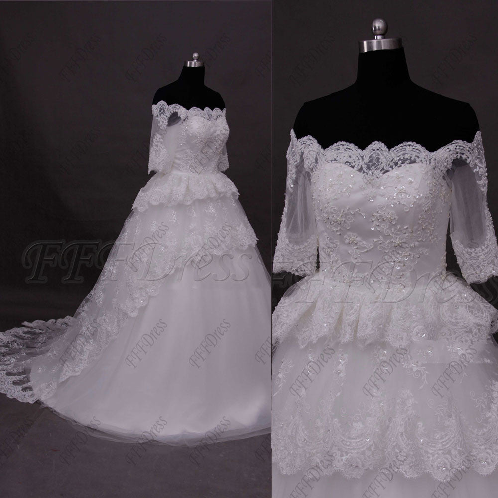 Off the shoulder tiered ball gown wedding dress with sleeves