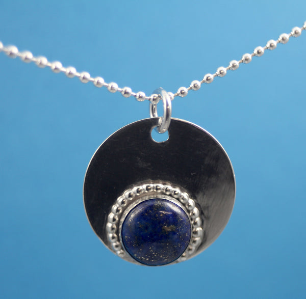 Pendants made from Sterling Silver and precious and semiprecious stones.