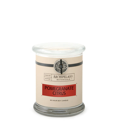 The Pomegranate Citrus Glass Jar Candle features a soy-wax blend of Blood Red Oranges, Grapefruit, and Red Currants - Archipelago
