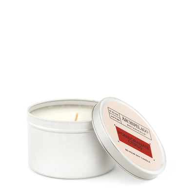 Pomegranate Citrus Travel Tin Candle features a distinctive blend of Pomegranates, Blood Red Oranges, Grapefruit, Red Currants, and Pineapple Bark Accord - Archipelago