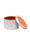 Positano Travel Tin Candle features a fragrance blend of White Nectarine, Persimmon, Pomegranate - Archipelago