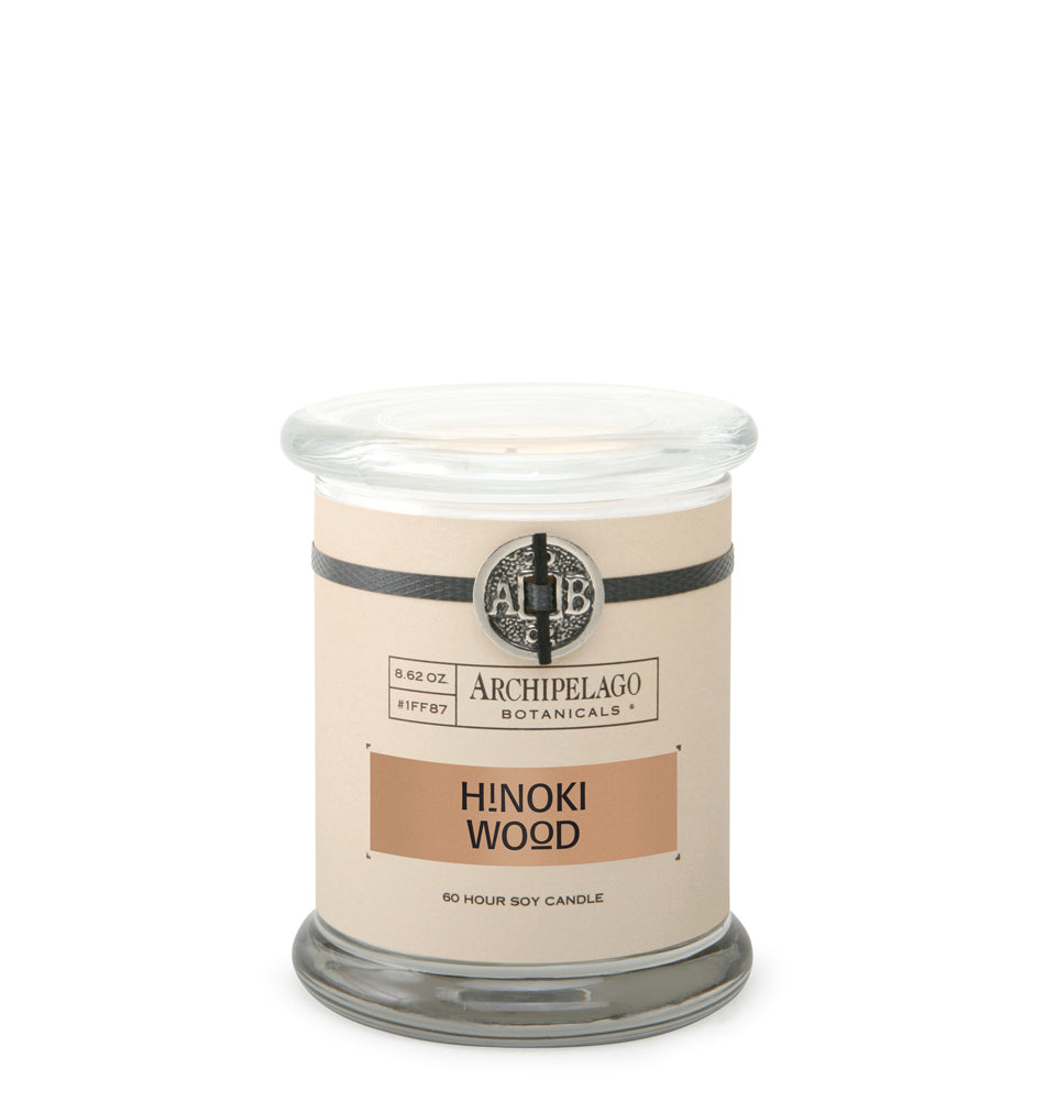 Hinoki Wood Glass Jar Candle is blended with Hinoki Wood, Sparkling Mandarin, Bois de Rose, and Geranium Blossoms to create a light and warm wood fragrance that is sweet and earthy - Archipelago