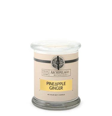 The Pineapple Ginger Glass Jar Candle features a blend of Pineapple Leaf, Ginger, Hibiscus Blossoms, and Fresh Nutmeg. Each candle is carefully poured with our clean soy wax blend using lead-free wicks - Archipelago