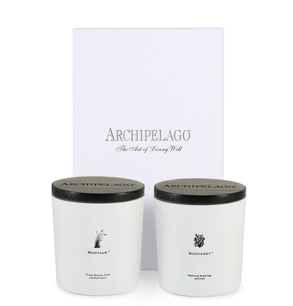 Coastal Grass Candle Duo Gift set contains a Montauk Lux Candle and a Monterey Luxe Candle packaged in an elegant white gift box. Both are made with coconut wax