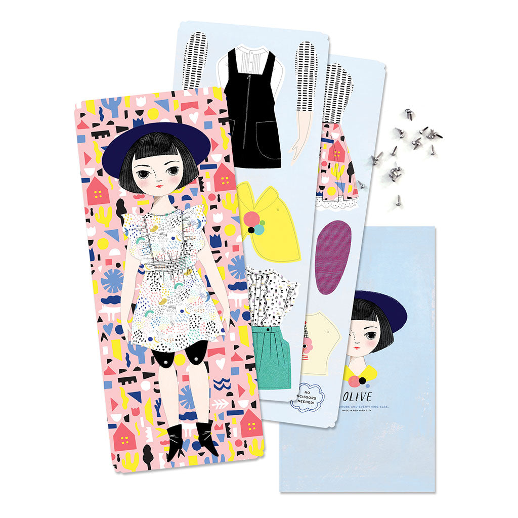 of unusual kind olive paper doll handmade in new york city made in usa contents