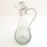 "Each.  7"" Glass Decantor"