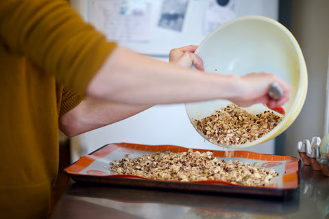 Pouring Granola On Our Baking Tray