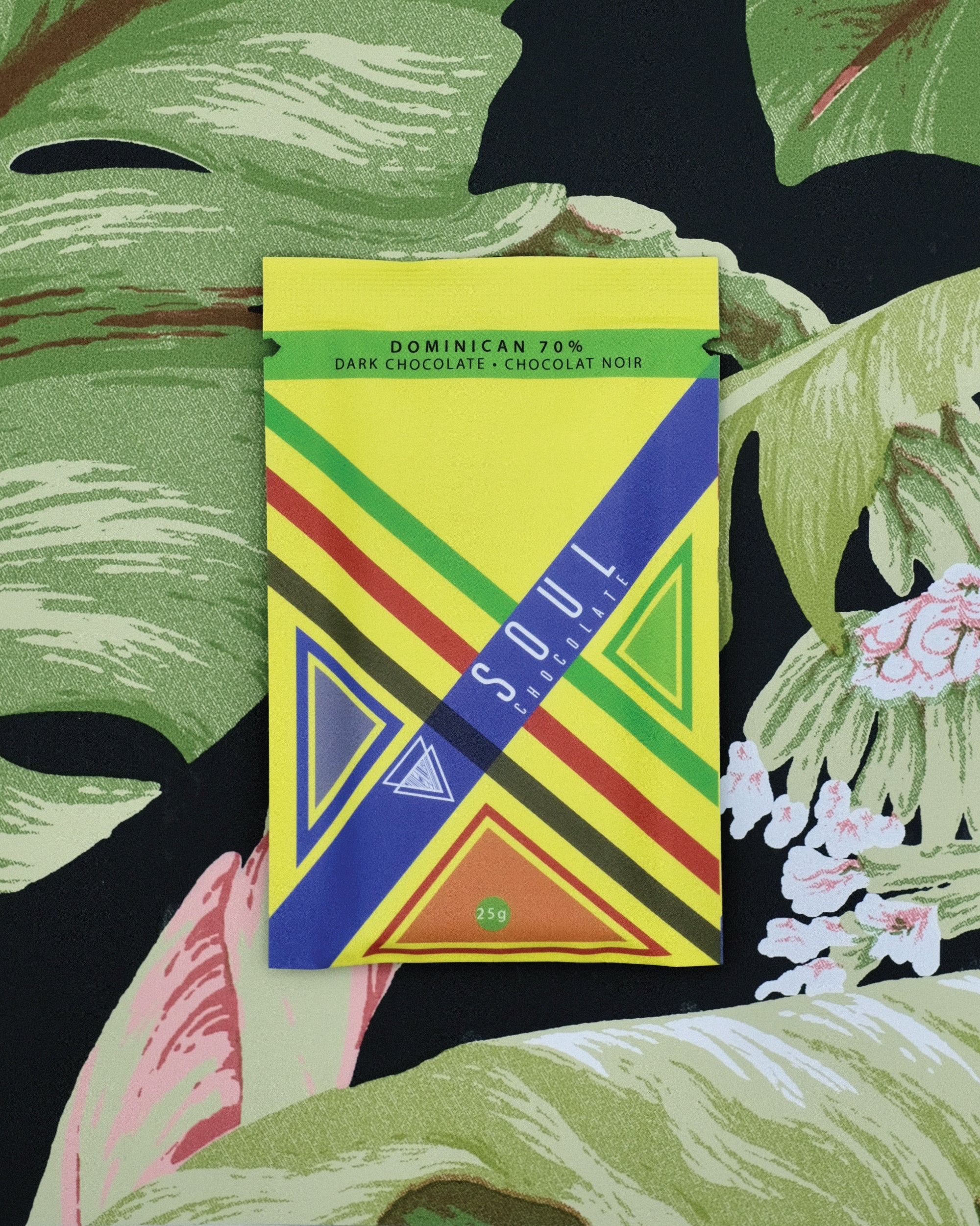 The front of our Dominican 70% Dark Chocolate bar has a fun pattern with colours found most commonly in Dominican.