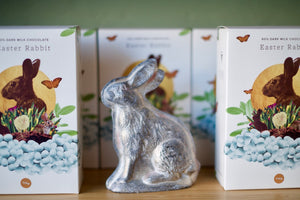 Our chocolate easter rabbits are displayed on our shelves beside a classic tin easter rabbit.