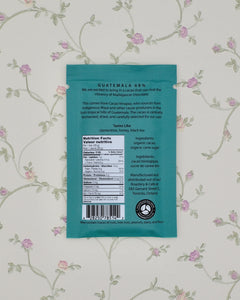 The back of our Guatemala 68% dark chocolate bar contains a description of the bar itself, nutrition info and ingredients