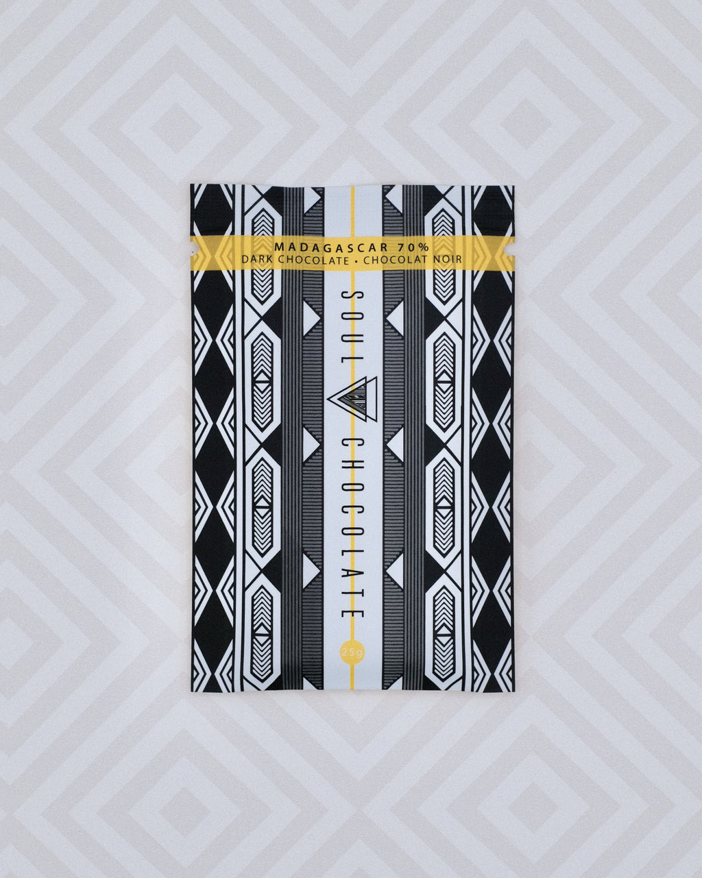 The front of our Madagascar 70% Dark Chocolate bar has a fun black and white textile pattern that we fell in love with. It reminds us of Madagascar every time we see it.