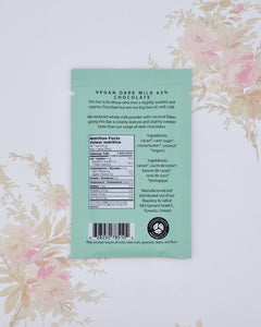 The back of our Vegan Dark Milk 63% Chocolate bar includes ingredient listing and nutritional information.