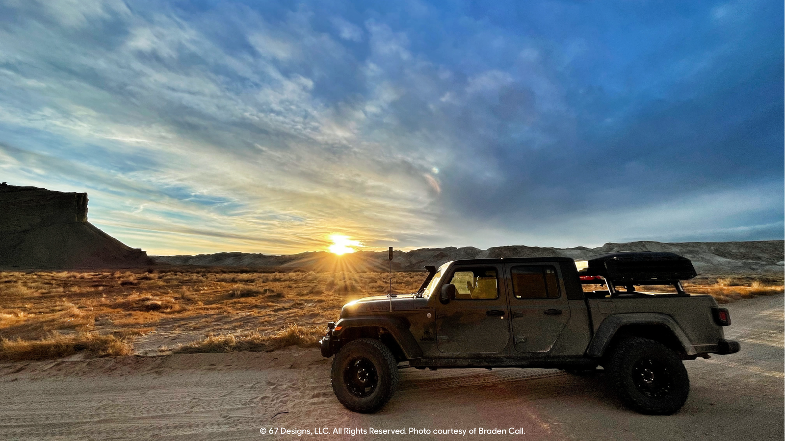 Sunset and blue skies behind the Jeep