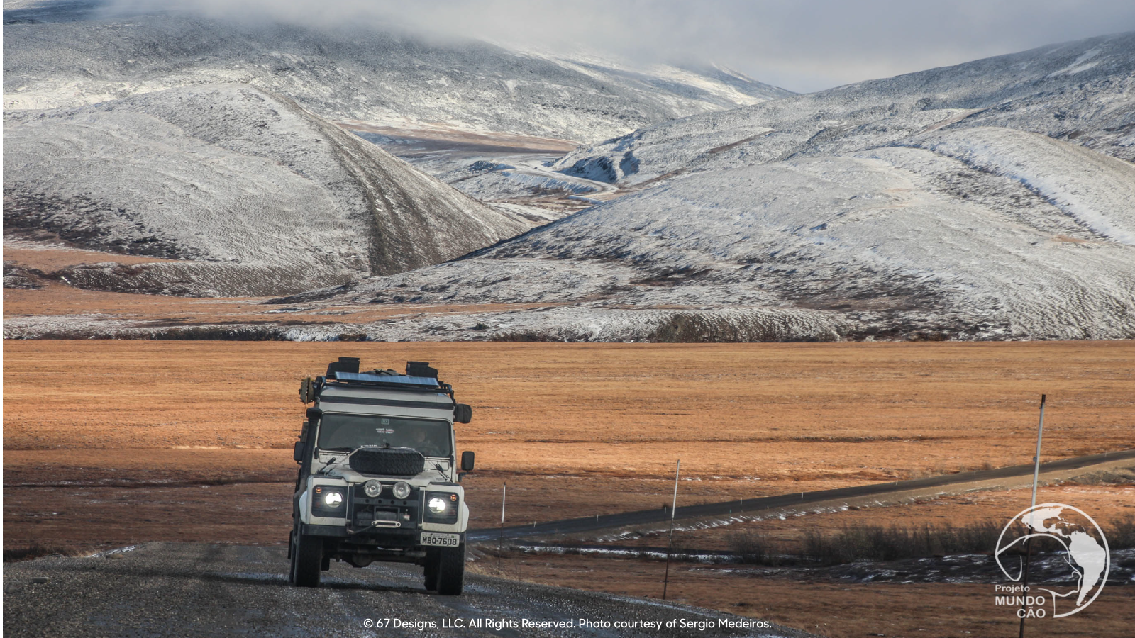 Land Rover on a long stretch of highway