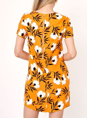 Our Orange Floral Shift Dress features a crew neck
