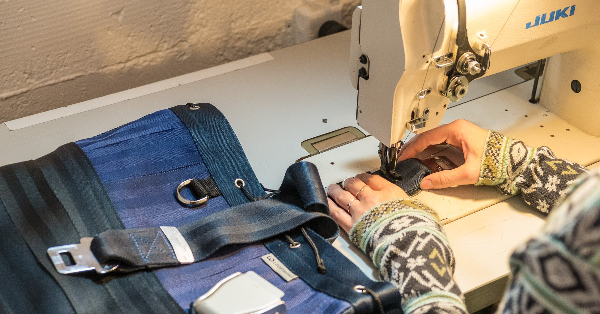 making a bag upcycled from Boeing seat belts