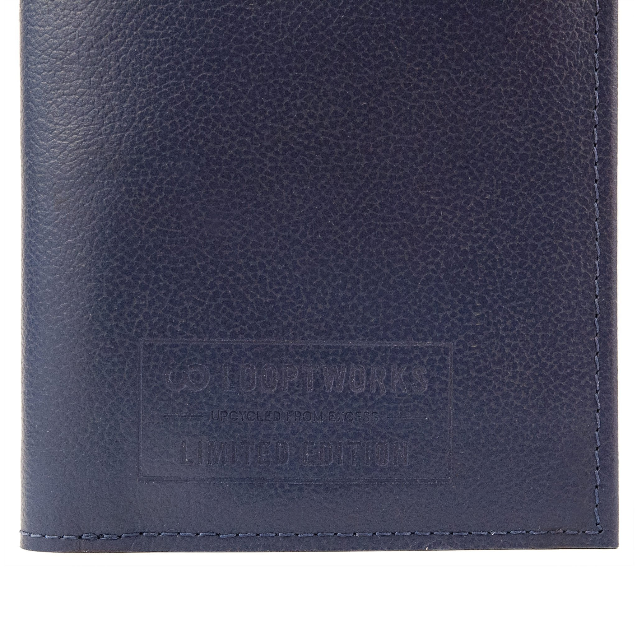 detail view of a blue and tan Passport Wallet made from leather upcycled from Southwest Airlines seat covers