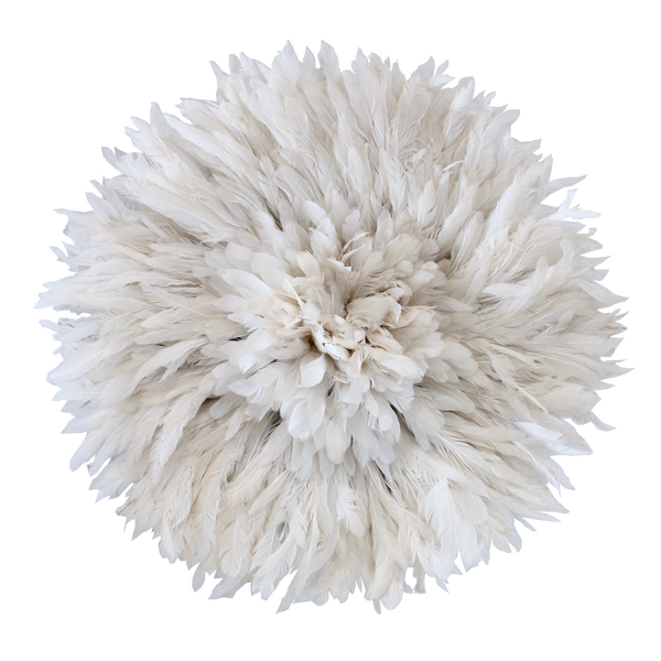 Traditional round headdress made from white feathers used as wall decor.