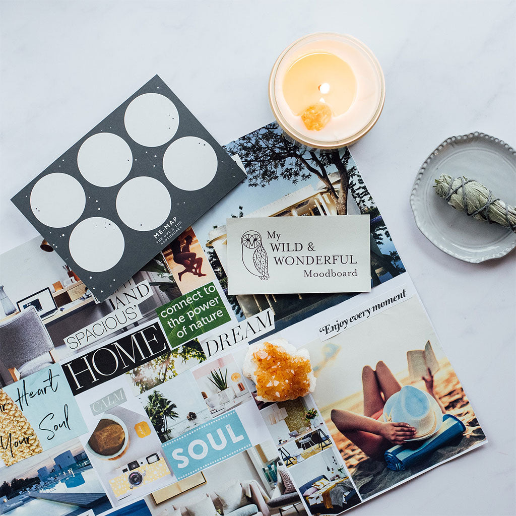 moodboard on table with candle and smudge stick