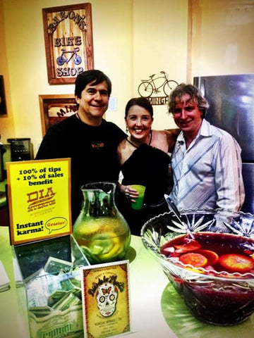 Matthew Lane and board members of bare Hands' Day of the Dead Festival are serving sangria during the opening reception for Calavera Prelude, an art celebration and fundraising show for Bare Hands 14th Day of the Dead Festival! 10% of show sales benefit the Festival.